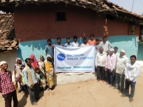 Kudo, India, villagers with Baltimore Aircoil Company banner (2).jpg